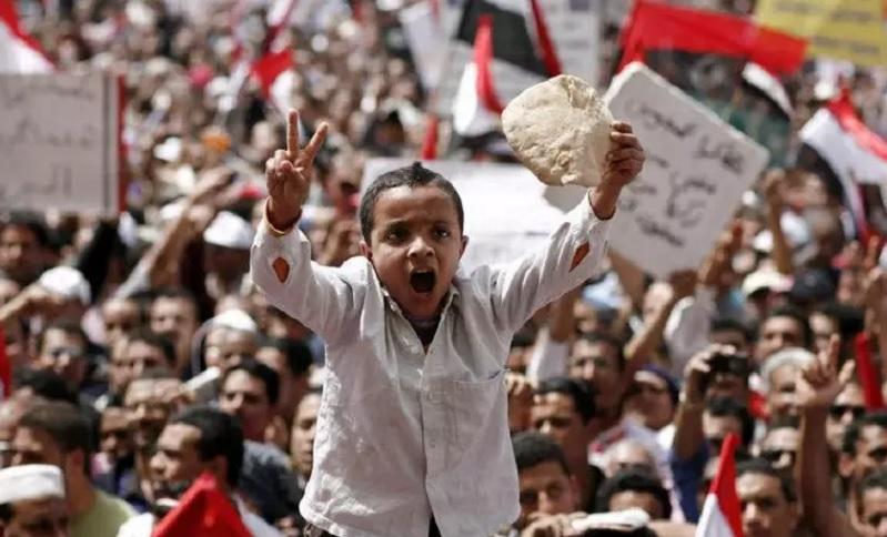 child holding bread in revolution