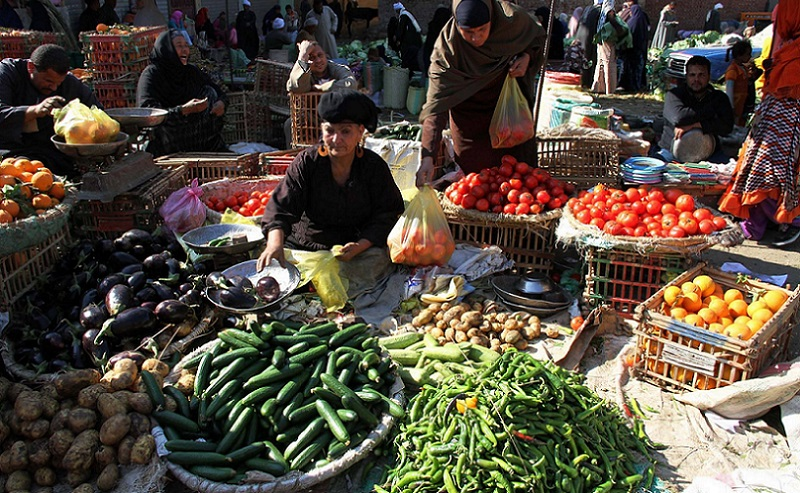 woman selling vegetables in a market