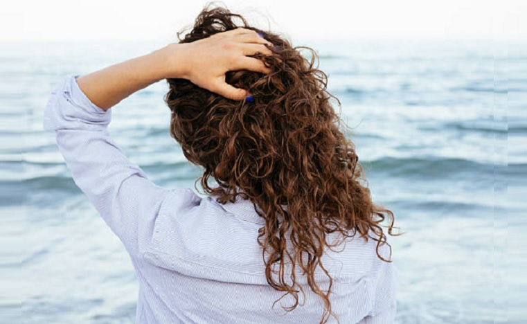 natural hair wind beach