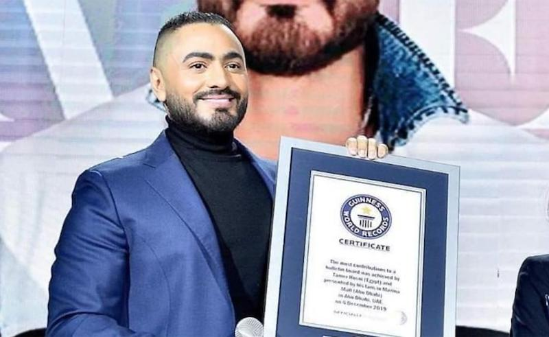 Hosny receiving his official certificate.