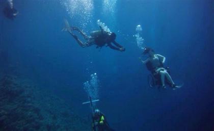 The Story Behind the Viral Underwater Wheelchair Photo in Sharm El Sheikh