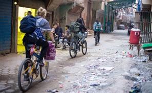Meet the Egyptian Girl Feeding the Poor 'Bel Bicycle'