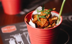 The Tap's New Weeknight Hungry Hour Will Leave You Up to Your Knees in Chicken Wings