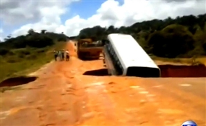 Video: Earth Swallows Bus Then Remarkably Spits It Out