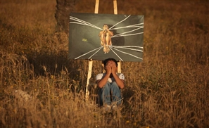 One Year On, Gaza's Young Picasso Paints the Scars of War
