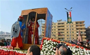 Why is There a Man in a Cage in Mansoura's National Day Parade?