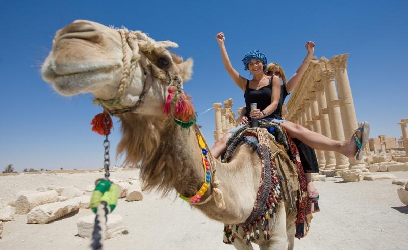 tourists,camel,ruins,ride,women
