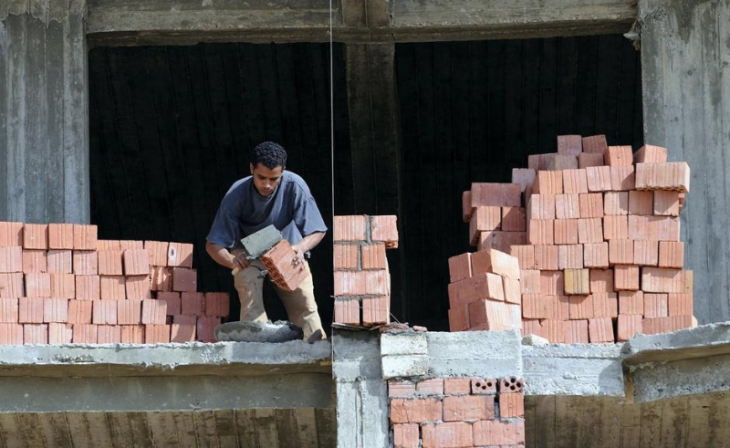 bricks construction worker building